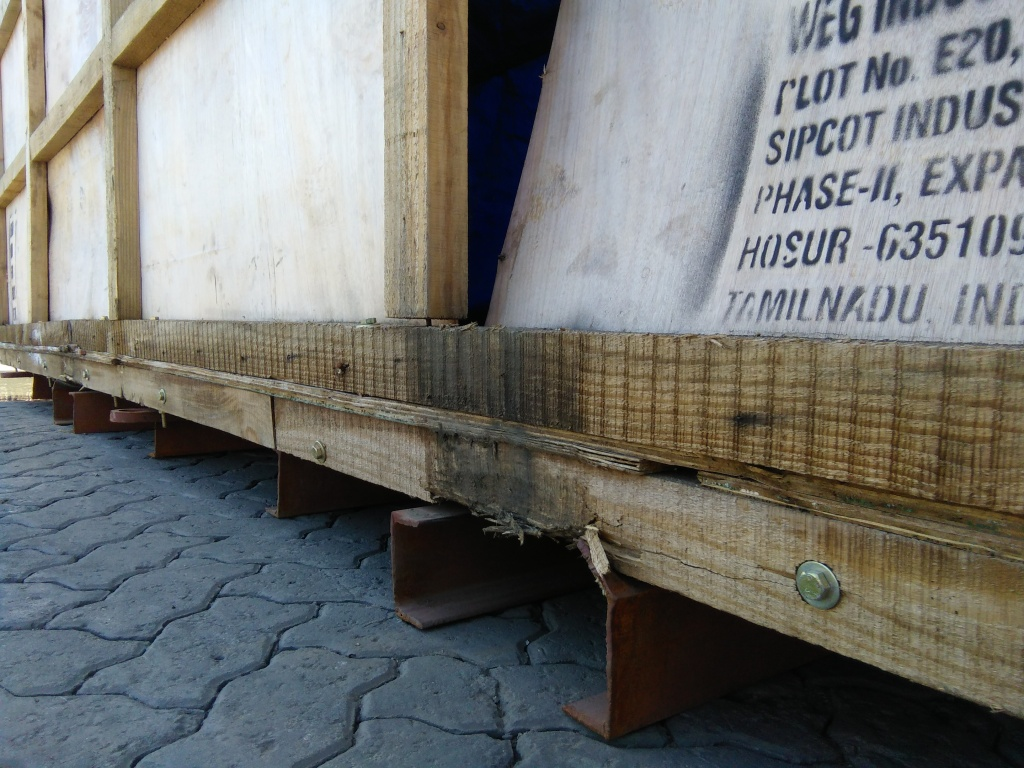 Damage Survey - Destuffing of a damaged wooden casing containing critical project cargo